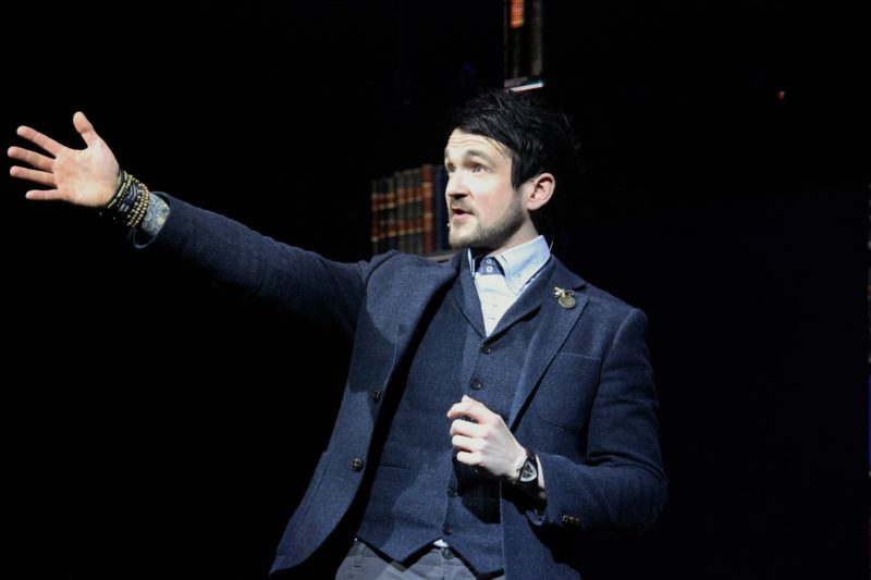 """Colin Cloud, also known as """"The Deductionist"""" points to an audience member to participate in his upcoming trick."""