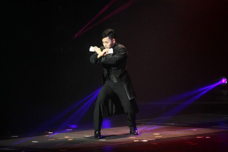 """An Ha Lim, also known as """"The Manipulator"""" dressed in full tuxedo, crosses his arms preparing for his magic trick."""