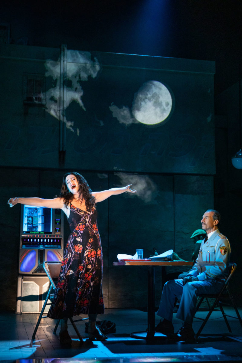 Dina, a café owner, sings of her childhood and the stars of the afternoon movie to Tewfiq, the conductor of the Alexandria Ceremonial Police Orchestra, in a restaurant in a scene from THE BAND'S VISIT